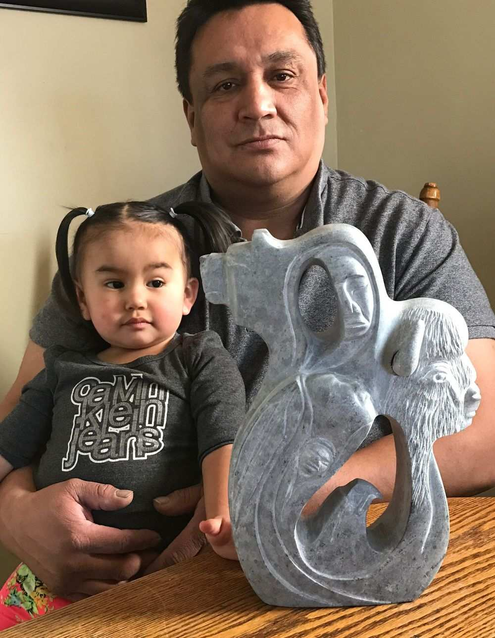 Artist Leo Arcand, from the Alexander First Nation, and his daughter, Morningstar, with a miniature model of the sculpture he'll be creating for the Capital Boulevard Canada 150 art project.